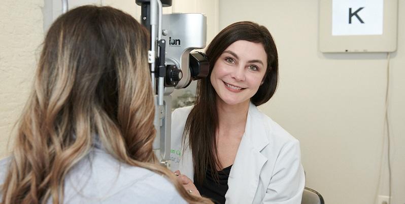 Eye Doctor Monique Jackson Performing Eye Exam for Diabetic